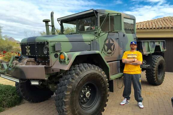 Former A's player Jonny Gomes stands next to the military truck he'll be using to help with relief efforts in Wine Country this weekend.