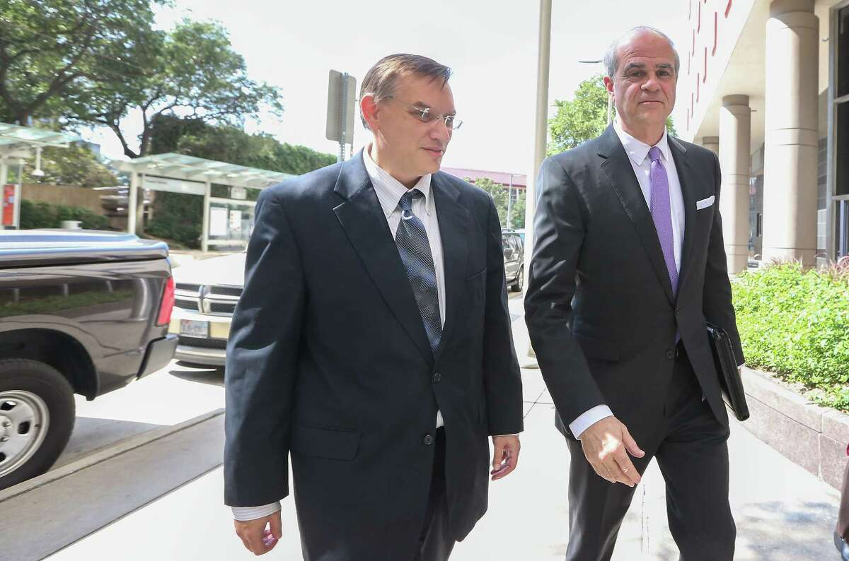 Jason Posey (left), former Rep. Steve Stockman's aide, enters the Bob Casey Federal Courthouse with his attorney Phil Hilder Wednesday, Oct. 11, 2017, in Houston.
