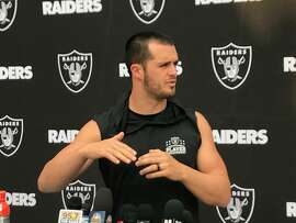 Raiders quarterback Derek Carr discusses his willingness to play against the Chargers this Sunday, two weeks after suffering a spinal fracture against Denver. (Al Saracevic/SF Chronicle)