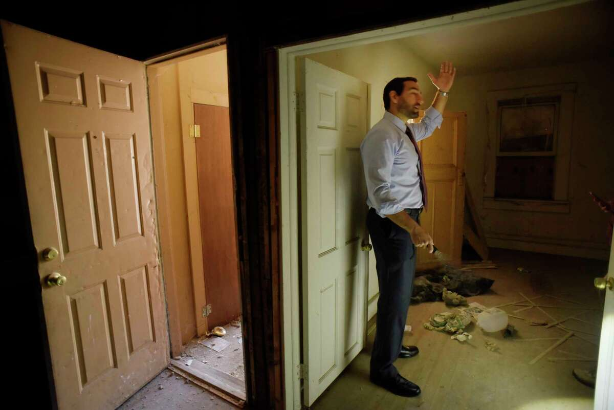 Adam Zaranko, executive director of the Albany County Land Bank, takes a tour of a building located at 29 Alexander Street on Wednesday, June 14, 2017, in Albany, N.Y. The Albany County Land Bank recently took over ownership of the property. (Paul Buckowski / Times Union)