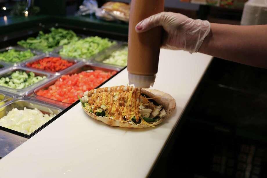 A new Pita Pit fast food restaurant will open Oct. 13 at 19111 Katy Freeway. Photo: Pita Pit