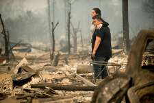 Gabriel Castillo and wife Alea Kelleher embrace while sifting through the remains of their Santa Rosa, Calif., home on Tuesday, Oct. 10, 2017. The two escaped along with their 13 month-old daughter, but lost their house as the Tubbs fire roared through the neighborhood early Monday morning.