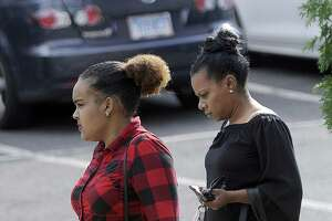 Anny Castillo, 22, who police say abandoned her baby hehind a downtown grocery store in the spring, leaves court Friday, Sept. 15, 2017, with an unidentified woman. Her case was continued until next month.