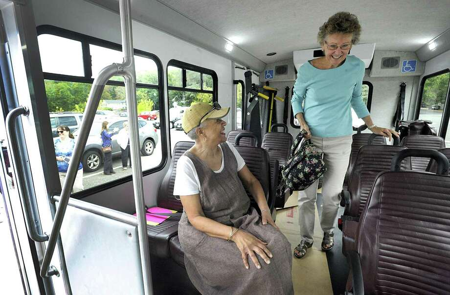 Jayne Isaacs, of Danbury, left, and Karen Kovacs, of Bethel, have a look inside the just-delivered handicapped accessible van for the Bethel Senior Center, Wednesday, Oct. 11, 2017.  This van will provide seniors with transportation to doctor's appointments, the grocery store and other important errands. Most other towns in the area already had a van for their elderly population. Photo: Carol Kaliff / Hearst Connecticut Media / The News-Times