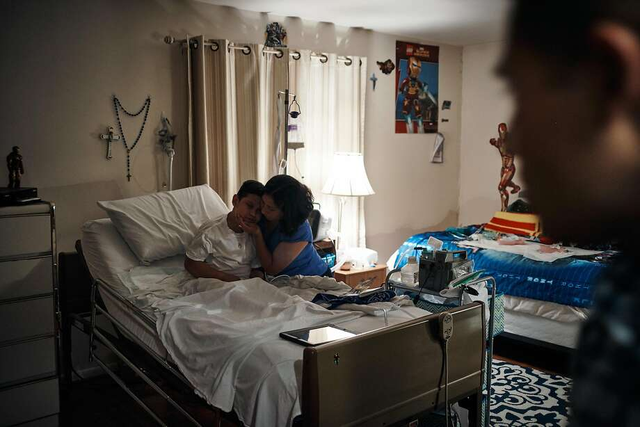 Brandon Rojas, with mother Liliana and father Paul Rojas, in their home in Dover Plains, N.Y., Oct. 3, 2017. His younger brother, Brian, received treatment in a clinical trial whose results show that gene therapy can stave off the disease with no side effects. (Misha Friedman/The New York Times) Photo: MISHA FRIEDMAN, NYT
