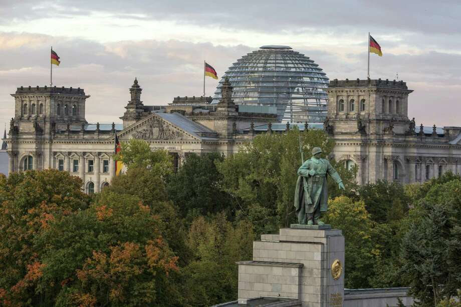 A view of the Bundestag (German parliament) and its glass dome, with the monument to the soviet soldier in the foreground on German Unity Day on Oct. 3 in Berlin. Photo: Omer Messinger / Getty Images / 2017 Getty Images