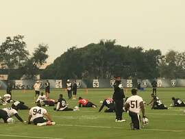 The Oakland Raiders practice under smoky skies on Oct. 11, 2017. Smoke from the North Bay fires caused the team to cut back practice by approximately 30 minutes. (Al Saracevic/SF Chronicle)