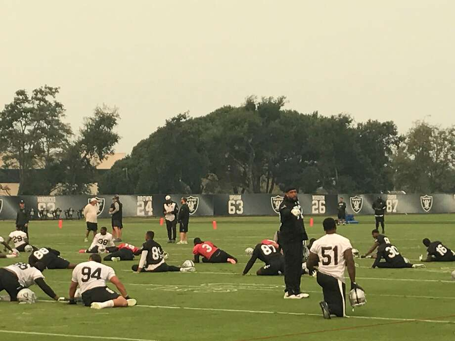 The Oakland Raiders practice under smoky skies on Oct. 11, 2017. Smoke from the North Bay fires caused the team to cut back practice by approximately 30 minutes. (Al Saracevic/SF Chronicle) Photo: Al Saracevic/SF Chronicle