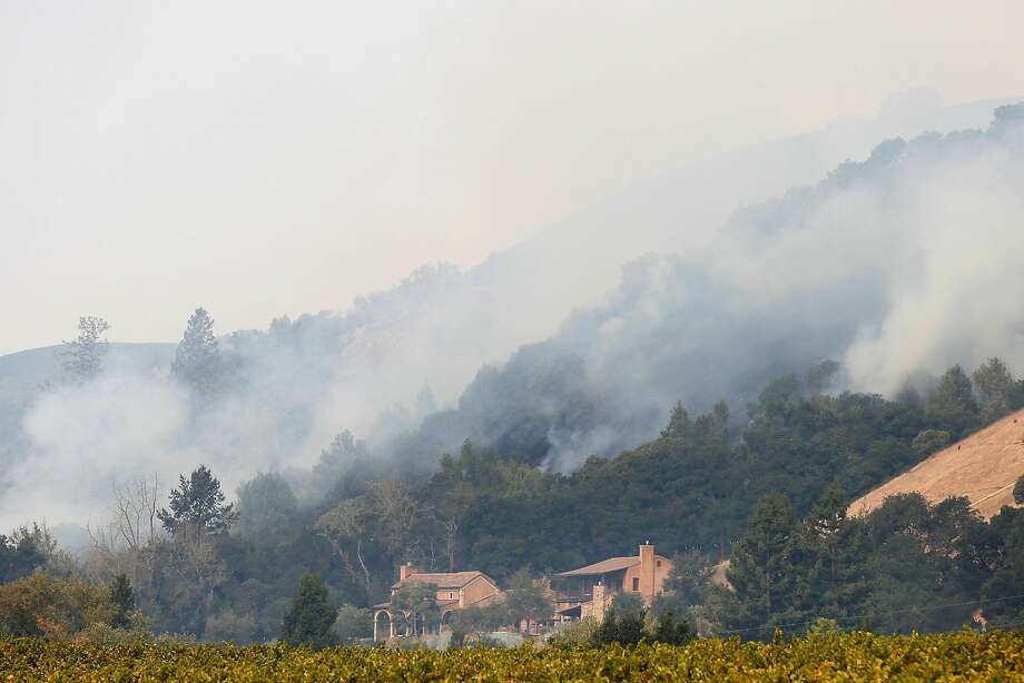 A structure sits below the smoke filling the hills behind it from the Tubbs fire on Wednesday, October 11, 2017 in Santa Rosa, Calif. Photo: Lea Suzuki, The Chronicle