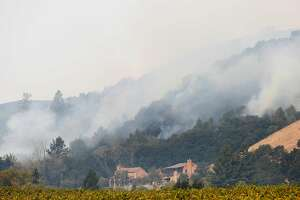 A structure sits below the smoke filling the hills behind it from the Tubbs fire on Wednesday, October 11, 2017 in Santa Rosa, Calif.