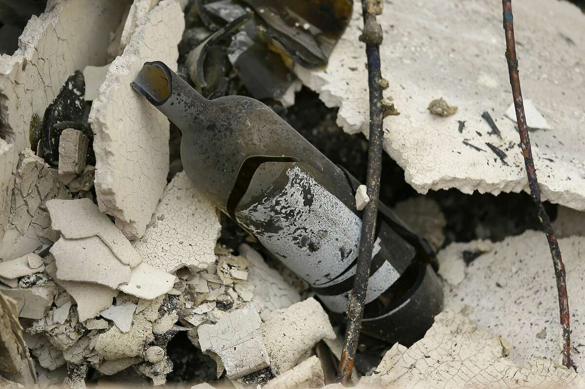 The remains of a burned bottle of wine are seen at the Signorello Estate winery Tuesday, Oct. 10, 2017, in Napa. Worried California vintners surveyed the damage to their vineyards and wineries Tuesday after wildfires swept through several counties whose famous names have become synonymous with fine food and drink.