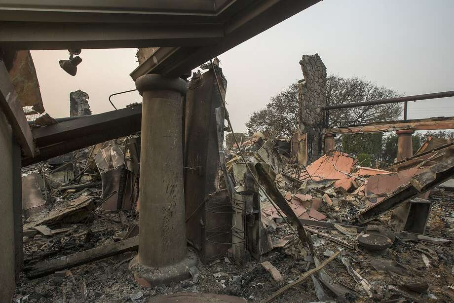 The family-owned winery, Signorello Estate, on Napa's Silverado Trail is left in ruins by the Atlas Fire on Oct. 11, 2017 near Napa. In one of the worst wildfires in state history, more than 2,000 homes have burned and at least 17 people have been killed as more than 14 wildfires continue to spread with little containment in eight Northern California counties. Photo: David McNew, Getty Images