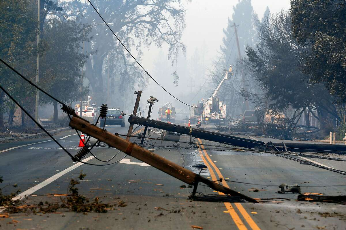 Utility crews begin the task of replacing the downed lines along Old Redwood Road in Santa Rosa, Ca. on Tuesday October 10, 2017. Massive wildfires ripped through Napa and Sonoma counties, destroying hundreds of homes and businesses on Monday morning.