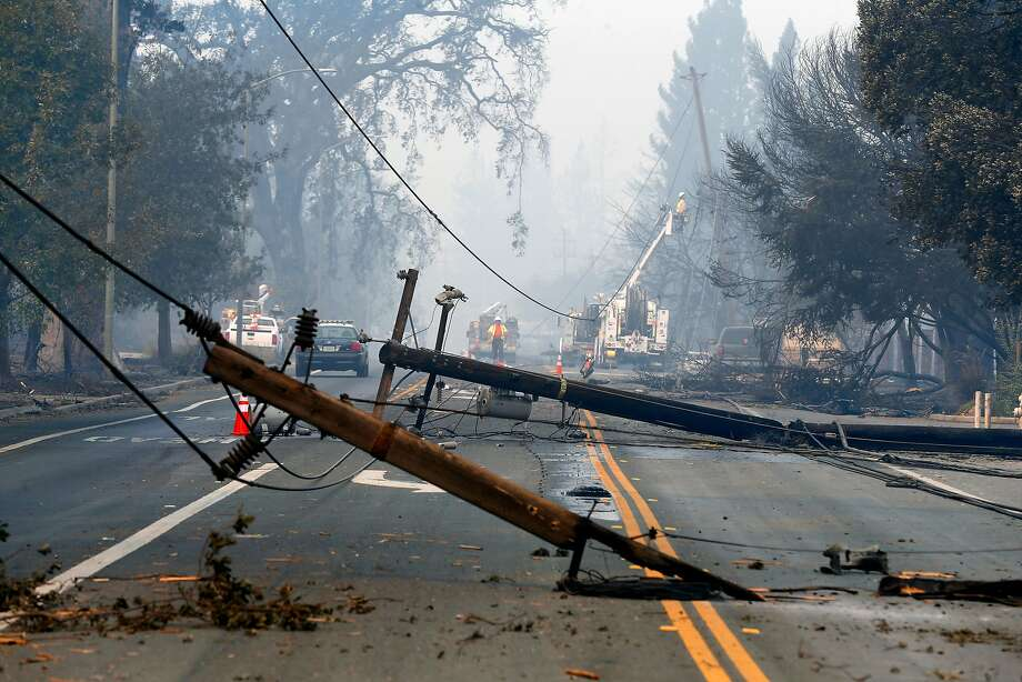 Utility crews begin the task of replacing the downed lines along Old Redwood Road in Santa Rosa, Ca. on Tuesday October 10, 2017. Massive wildfires ripped through Napa and Sonoma counties, destroying hundreds of homes and businesses on Monday morning. Photo: Michael Macor / The Chronicle 2017