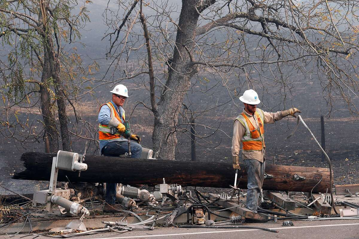 PG & E crews begin the task of replacing the downed power poles along Old Redwood Road in Santa Rosa, Ca. on Tuesday October 10, 2017. Massive wildfires ripped through Napa and Sonoma counties, destroying hundreds of homes and businesses on Monday morning.