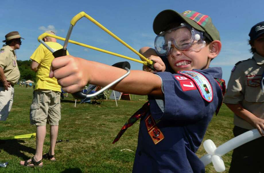 Pack 97  cub scout Stephen Artale trakes target prctice with a wrist rocket sling shot during the 'Norwalk Scouting Adventure' at Taylor Farm in Norwalk Saturday, August 29, 2015. Photo: Erik Trautmann / Hearst Connecticut Media File / Norwalk Hour file photo