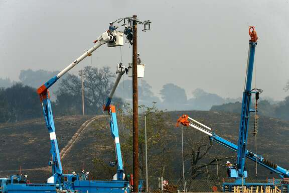PG & E crews busy restoring power along Old Redwood road in Santa Rosa, Ca. on Tuesday October 10, 2017. Massive wildfires ripped through Napa and Sonoma counties, destroying hundreds of homes and businesses on Monday morning.