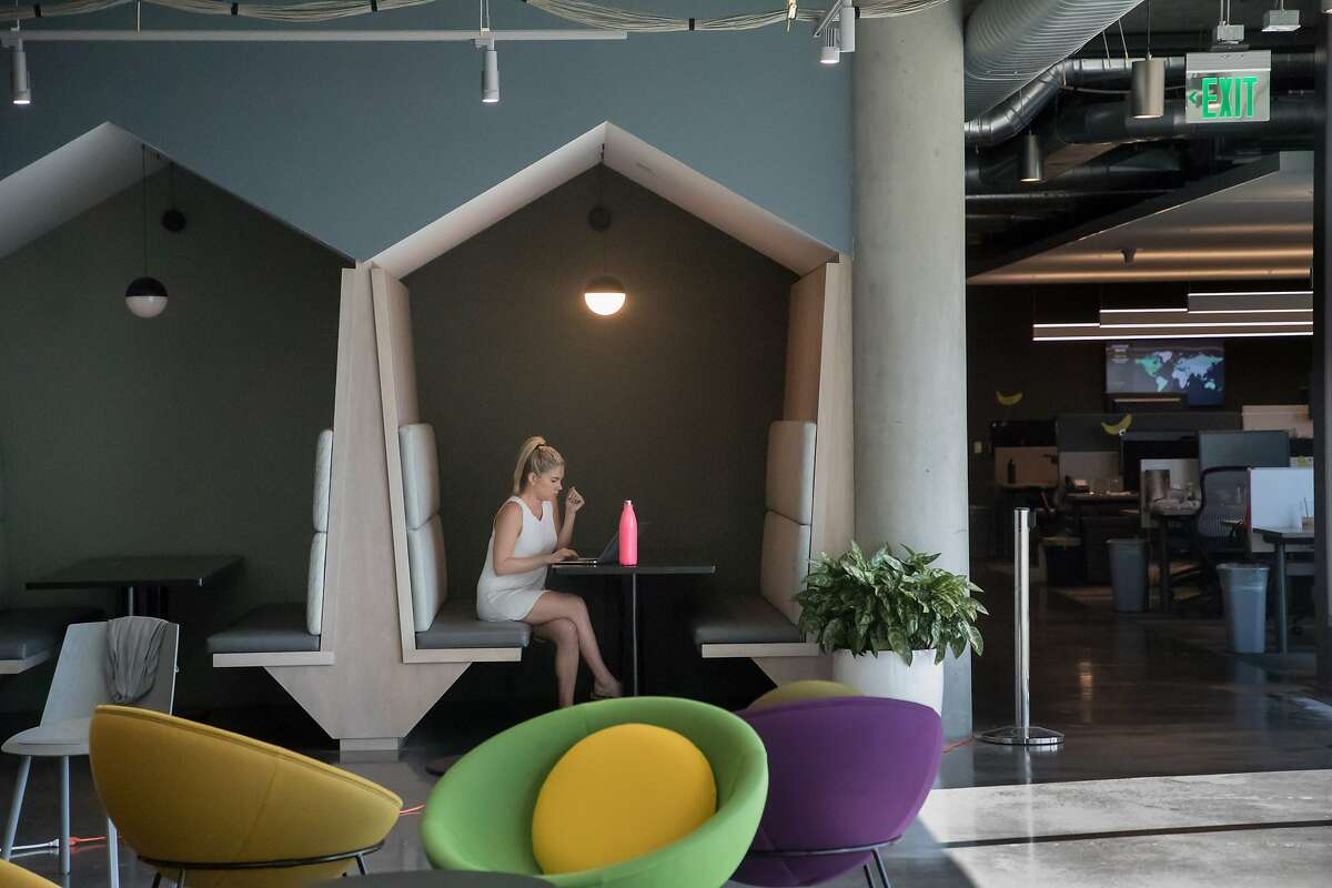 Hayley Inkster works near a cafe at SurveyMonkey HQ on Oct. 6, 2017 in San Mateo.