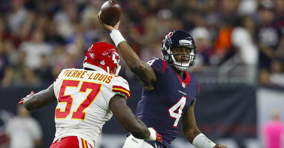 Houston Texans quarterback Deshaun Watson (4) throws pat Kansas City Chiefs linebacker Kevin Pierre-Louis (57) during the first quarter of an NFL football game at NRG Stadium on Sunday, Oct. 8, 2017, in Houston. ( Brett Coomer / Houston Chronicle ) Photo: Brett Coomer/Houston Chronicle
