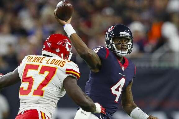 Houston Texans quarterback Deshaun Watson (4) throws pat Kansas City Chiefs linebacker Kevin Pierre-Louis (57) during the first quarter of an NFL football game at NRG Stadium on Sunday, Oct. 8, 2017, in Houston. ( Brett Coomer / Houston Chronicle )