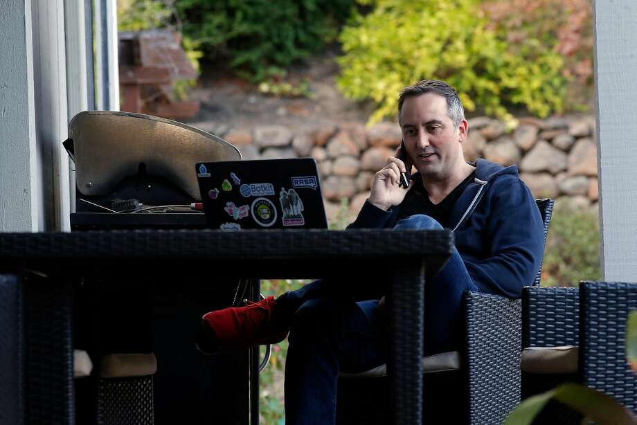 Paul Walsh, CEO of startup MetaCert, often at times communicates with team members in other countries while working from his home in Danville. Photo: Michael Macor, The Chronicle