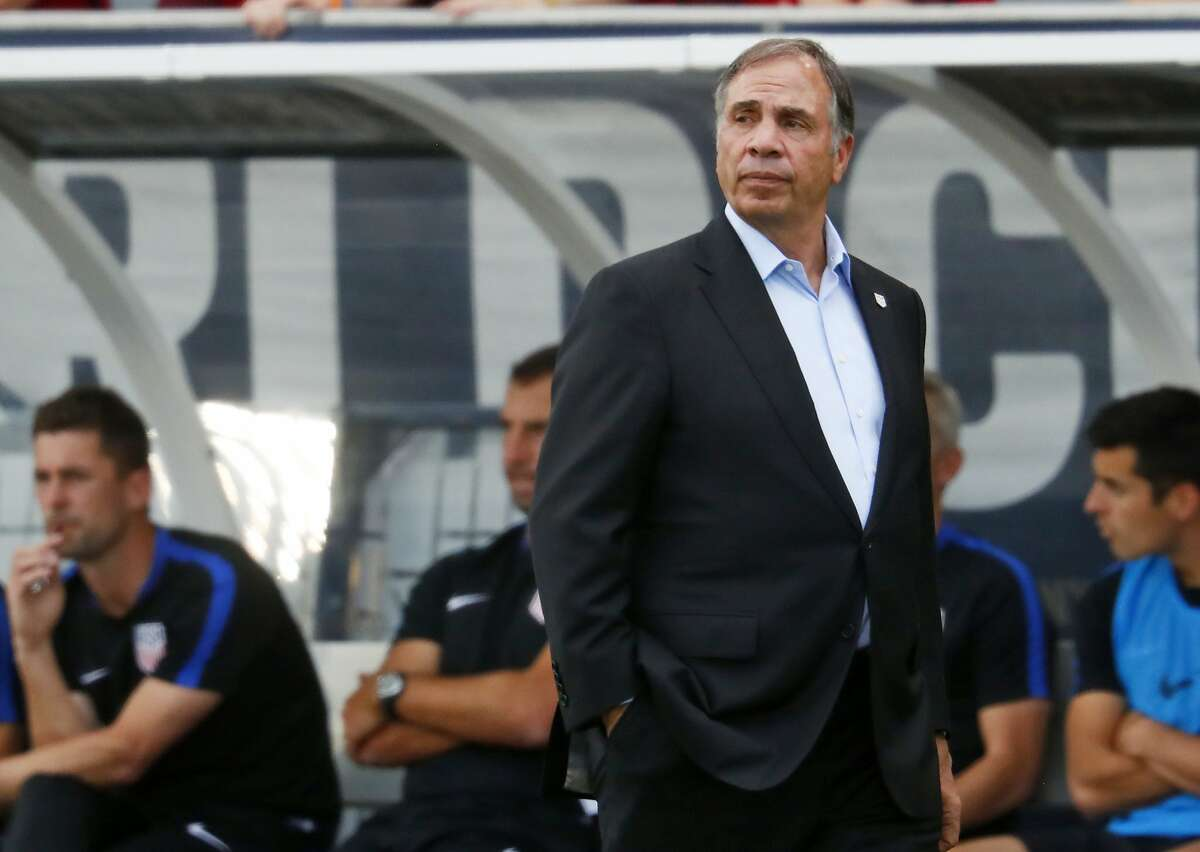 FILE- In this June 8, 2017, file photo, United States coach Bruce Arena watches during the first half of the team's World Cup soccer qualifying match against Trinidad & Tobago in Commerce City, Colo. A bumbling, stumbling, tumbling qualification campaign ended with a 2-1 loss to an already eliminated Caribbean nation. Now comes the fallout, which almost surely will lead to a new coach and possibly to a new head of the U.S. Soccer Federation. (AP Photo/David Zalubowski, File)