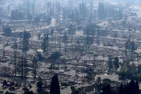 SANTA ROSA, CA - OCTOBER 11:  An aerial view of homes that were destroyed by the Tubbs Fire on October 11, 2017 in Santa Rosa, California. Twenty one people have died in wildfires that have burned tens of thousands of acres and destroyed over 3,000 homes and businesses in several Northen California counties.  (Photo by Justin Sullivan/Getty Images)