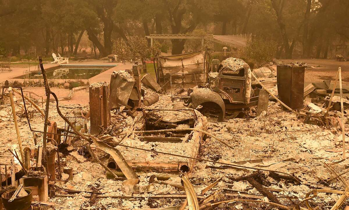 TOPSHOT - A burned home smolders in Glen Ellen, California on October 9, 2017. Multiple wind-driven fires continue to ravage the area burning structures and causing widespread evacuations. / AFP PHOTO / JOSH EDELSONJOSH EDELSON/AFP/Getty Images