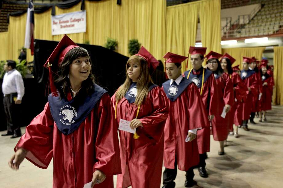 Students graduate from Travis Early College High School in 2012. Its partnership with San Antonio College is closing the education gaps for Hispanic students. Photo: File Photo /San Antonio Express-News / SAN ANTONIO EXPRESS-NEWS