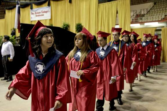 Students graduate from Travis Early College High School in 2012. Its partnership with San Antonio College is closing the education gaps for Hispanic students.