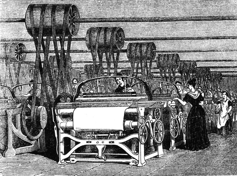 Power looms being used in textile manufacturing during the industrial revolution. Photo: Hulton Archive, Getty Images