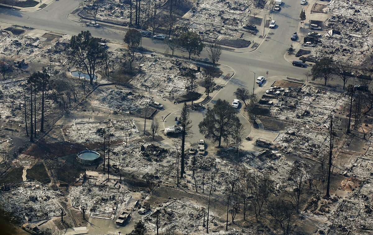 Burned out homes are seen in the Coffey Park area Wednesday, Oct. 11, 2017, in Santa Rosa, Calif. Wildfires whipped by powerful winds swept through Northern California sending residents on a headlong flight to safety through smoke and flames as homes burned. (AP Photo/Rich Pedroncelli)