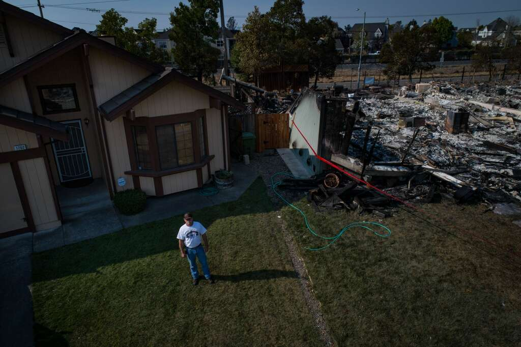Wayne Sims Stands Outside His Home One Of The Few That Escaped Destruction By Wildfire