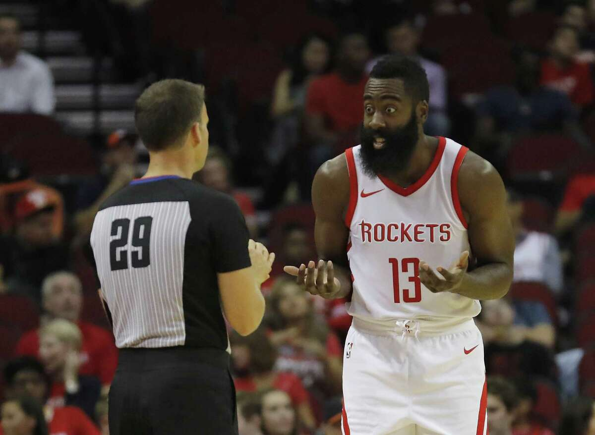 Rockets star James Harden is using the preseason to see how officials such as Mark Lindsay, left, handle the NBA's clarification on calling shooting fouls