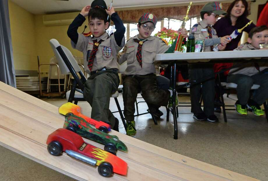 Scouts including Aron Hedberg and Jack Kulangara watch the races during the Cub Scout Pack 97's annual Pinewood Derby in January at St Jerome's Church in Norwalk. Photo: Erik Trautmann / Hearst Connecticut Media / Norwalk Hour
