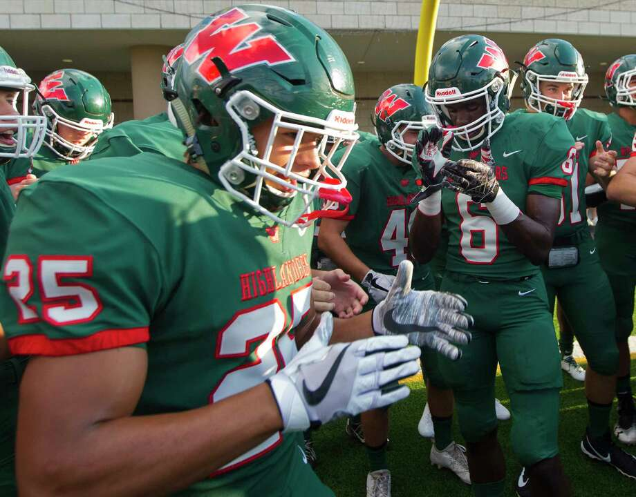 The Woodlands wide receiver Kesean Carter (6) takes in a moment alongside running back Bryeton Gilford (25) before a non-district high school football game against George Ranch at Woodforest Bank Stadium, Friday, Sept. 22, 2017, in Shenandoah. Photo: Jason Fochtman, Staff Photographer / © 2017 Houston Chronicle