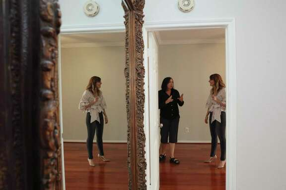 Mara Reid, left, who relocated to Houston in June with her husband from Austin, is touring a West University condo that her sister recently purchased for her mother to move in, also from Austin, with her realtor Ellie Riney Wednesday, Oct. 11, 2017, in Houston. Reid and Riney were going to meet with Reid's contractors to discuss changes in the condo. ( Yi-Chin Lee / Houston Chronicle )