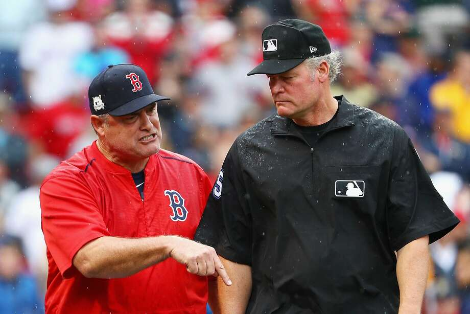 John Farrell (left) was ejected from Game 4 of the ALDS on Monday. It turned out to be his last game as Red Sox manager. Photo: Maddie Meyer, Getty Images
