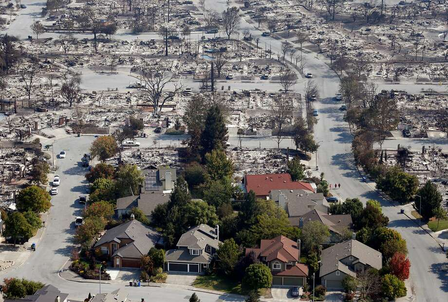 Homes that appear undamaged by Sunday night's firestorm remain near others that burned to the ground in the Coffey Park neighborhood in Santa Rosa, Calif. on Wednesday Oct. 11, 2017. Photo: Paul Chinn, The Chronicle