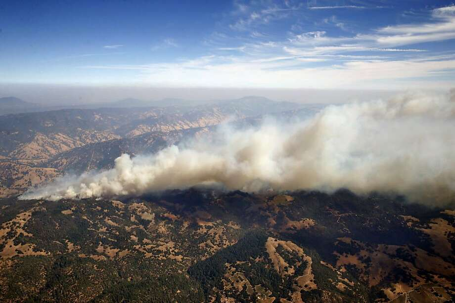 Smoke from the Tubbs Fire rises high into the air as the firestorm continues to burn out of control near Santa Rosa, Calif. on Wednesday Oct. 11, 2017. Photo: Paul Chinn, The Chronicle