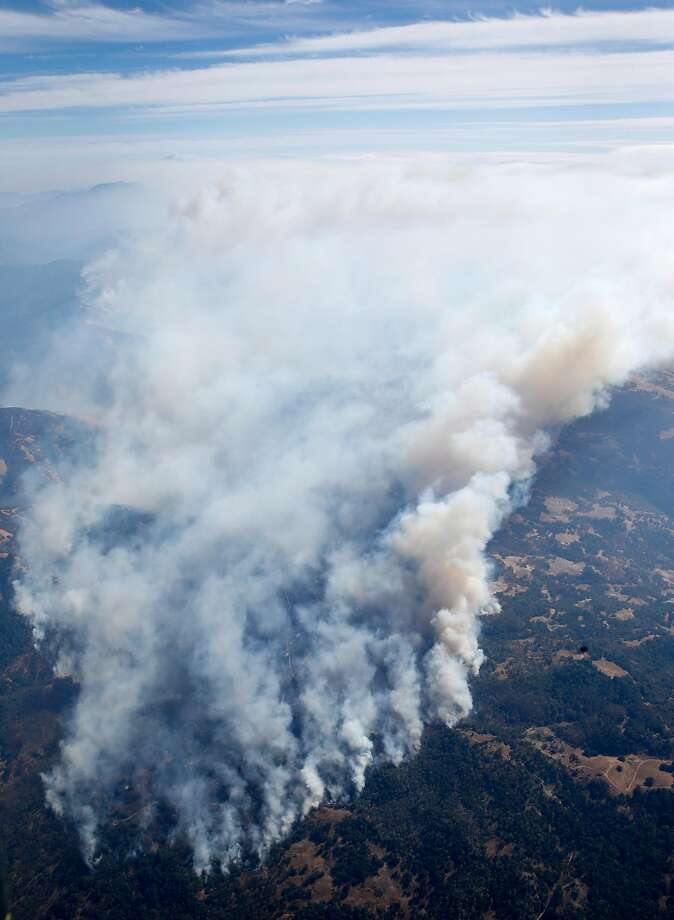 Smoke from the Tubbs Fire rises high into the air on Wednesday Oct. 11, 2017. Click through the gallery to see before and after photos of the devastation. Photo: Paul Chinn, The Chronicle