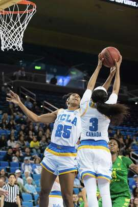 LOS ANGELES, CA - JANUARY 15: UCLA Bruins forward Monique Billings (25) and UCLA Bruins guard Jordin Canada (3) go for a rebound during the game between the Oregon Ducks and the UCLA Bruins on January 15, 2017, at Pauley Pavilion in Los Angeles, CA. (Photo by David Dennis/Icon Sportswire via Getty Images)