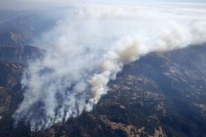 Smoke from the Tubbs Fire rises high into the air as the firestorm continues to burn out of control near Santa Rosa, Calif. on Wednesday Oct. 11, 2017.