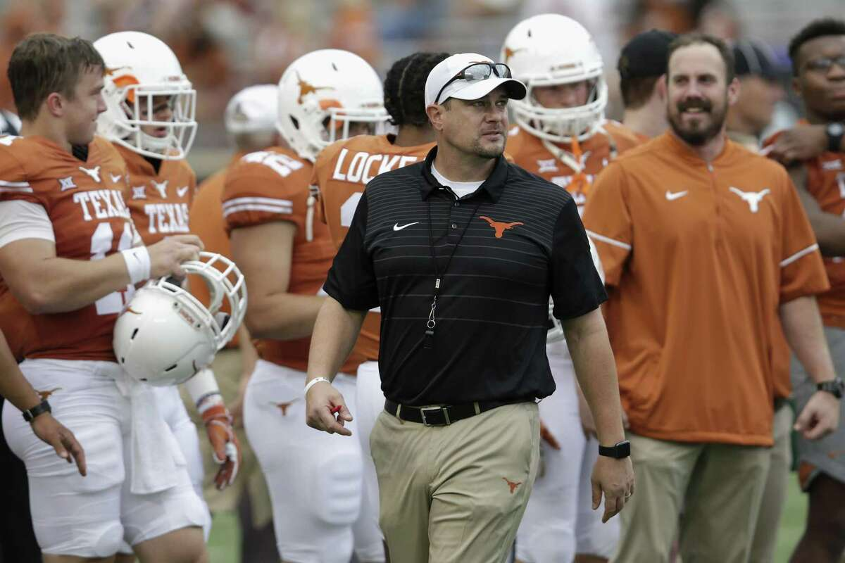 AUSTIN, TX - OCTOBER 07: Head coach Tom Herman of the Texas Longhorns watches players warm up before the game against the Kansas State Wildcats at Darrell K Royal-Texas Memorial Stadium on October 7, 2017 in Austin, Texas. (Photo by Tim Warner/Getty Images)