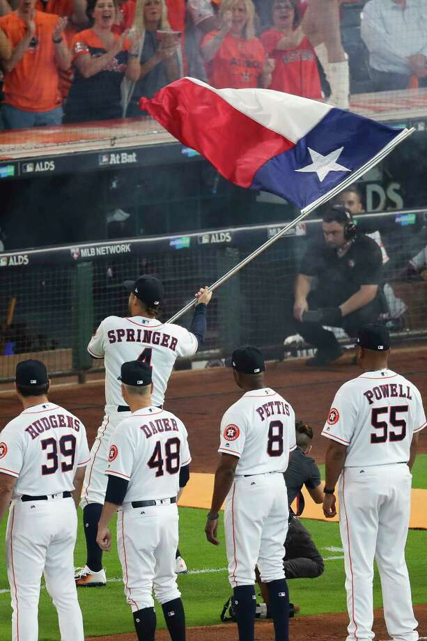 Houston Astros center-fielder George Springer runs onto the field with the Texas flag before the Houston Astros take on the Boston Red Sox at Minute Maid Park on Oct. 5. ( Michael Ciaglo / Houston Chronicle) Photo: Michael Ciaglo, Houston Chronicle / Michael Ciaglo