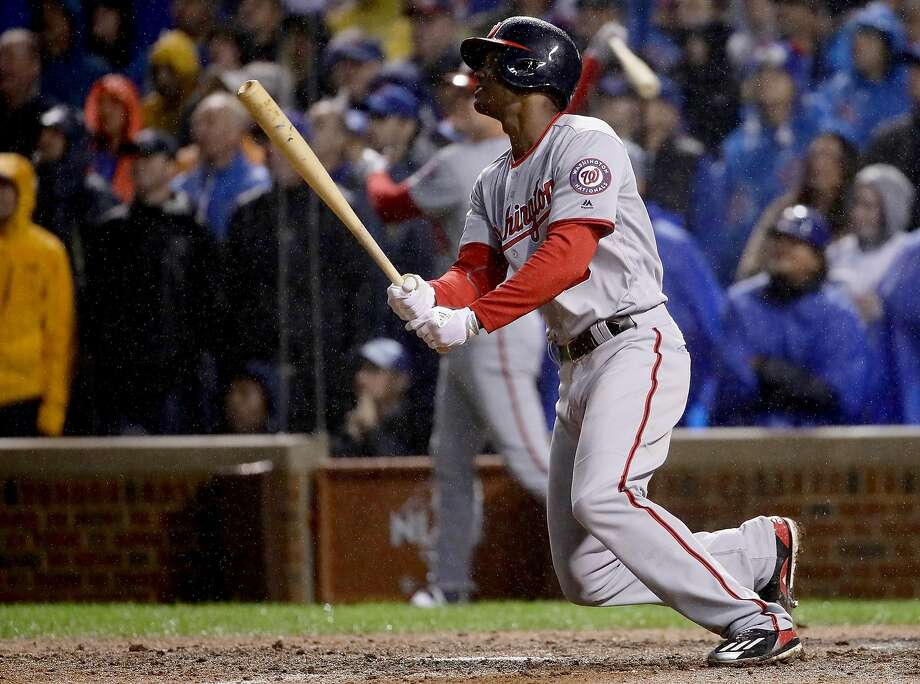 Michael Taylor's grand slam in the rain in the eighth broke open the game for Washington. Photo: Jonathan Daniel, Getty Images