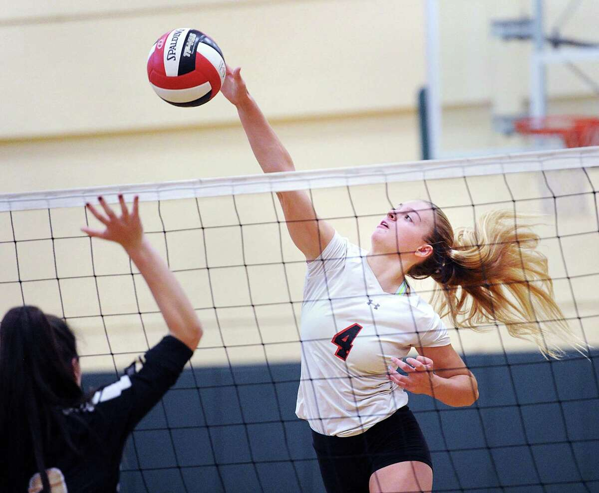 Greenwich's Tara Ford goes for the kill during the Cardinals' 3-1 victory over Trumbull on Wednesday in Greenwich. Ford finished with 17 kills, three blocks and three digs.