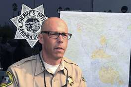 """Sonoma County Sheriff Rob Giordano briefs the media at a news conference in Santa Rosa, Calif. on Wednesday, Oct. 11, 2017. Giordano who put the number of people unaccounted for in the hard-hit county at 380, said """"We are not switching operations to anything but lifesaving right now, It's all about lifesaving and evacuations,"""" (AP Photo/Paul Elias)"""