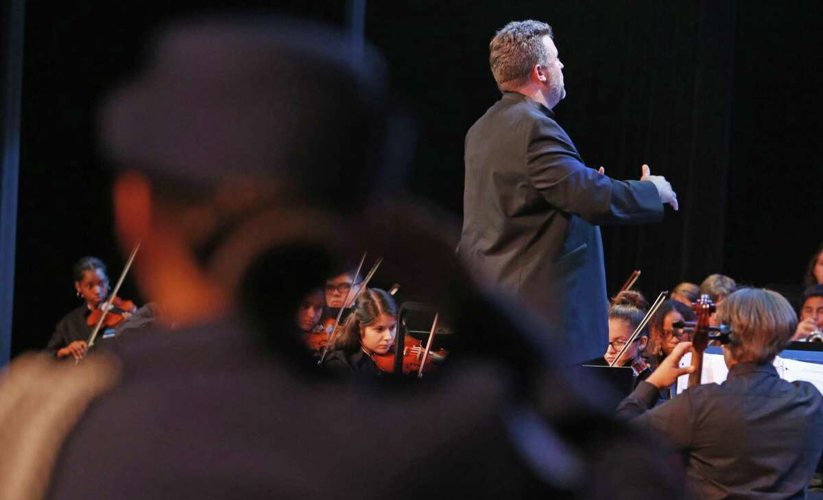 Harlan symphony plays during ceremony in auditorium. NISD has a tradition of naming high schools after Justices of the Supreme Court of the United States. Harlan High School is the largest high school in Northside and the newest, having just opened this fall. This evening it will have its naming dedication ceremony, with the great great granddaughters of the Supreme Court Justice Harlan: the managing editor of The Christian Science Monitor and her sister Kate Dillingham, a world renowned cellist on Wednesday, October 11, 2017