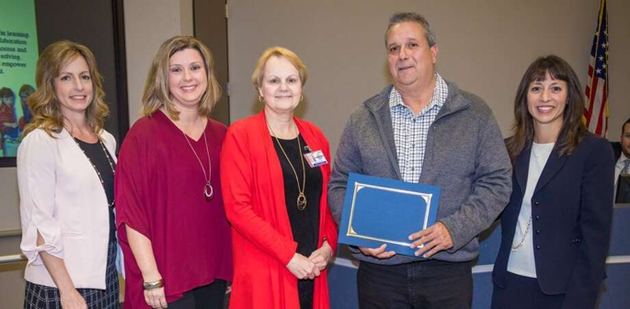 Humble ISD's Super Staffers of the Month were recognized at the regularly scheduled Board Meeting on Oct. 10 and sponsored by Humble ISD Education Foundation. Pictured, from left, are School Board President Angela Conrad, Humble ISD Education Foundation Board Chairwoman Jen Sitton, Child Nutrition Services Maintenance Supervisor Henry Parrish, and Superintendent Elizabeth Fagen. Not pictured are Deerwood Paraeducator Dawn Swanson and Timberwood Social Studies Teacher Layna Murphy. Photo: Courtesy